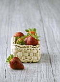 Fresh strawberries in a small basket