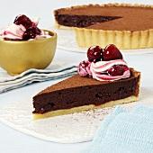 Piece of chocolate cherry tart