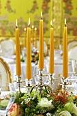 Candelabrum with flower arrangement on festive table