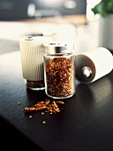 Dried chillies in glass spice mills