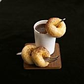 Three mini doughnuts with chocolate sauce