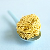 A nest of egg noodles on a spoon