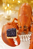 Caviar substitute on toast on lobster claw