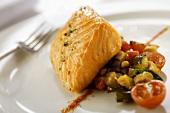 Salmone e caponata (Poached salmon on sweet & sour vegetables)