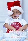 'Junger Bäcker' beim Teig kneten