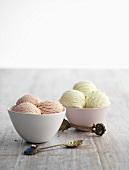 Strawberry ice cream and pistachio ice cream in two bowls