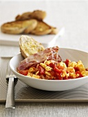 Piperade (Basque pepper omelette) with ham and bread