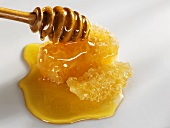 Honeycomb with honey and honey dipper