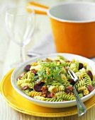 Pasta salad with diced bacon and chorizo