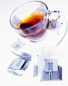 Tea bag in glass teacup