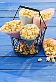 Bags of popcorn in a wire basket