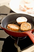 Frying tomato halves in frying pan