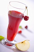 A glass of apple and cherry juice