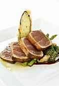 Seared tuna slices on bed of vegetables