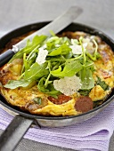 Peasant omelette with rocket in frying pan
