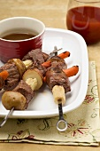 Skewered meat and vegetables with two sauces