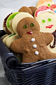 Gingerbread men (in gingerbread & plain biscuit dough) in basket