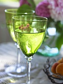 White wine in two green glasses