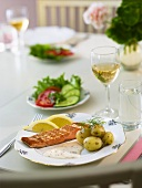 Salmon steak with herb sauce & boiled potatoes (in their skins)