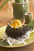 Sea urchin with strips of radish