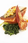 Salmon steak and lobster claw with spinach