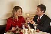 Young couple admiring ring on woman's finger