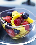 Mango and mixed berry salad with vodka
