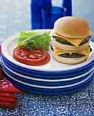 A double cheeseburger with tomato and lettuce
