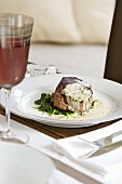 Fillet steak stuffed with chilli and garlic on spinach