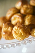 Gougères (cheese puffs, France) on a glass plate