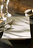 Rectangular plate with cutlery on a slate slab