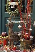 Christmas display with wicker reindeer and arrangements
