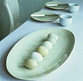Pale green hens' eggs on a platter