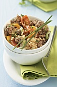 Rice and vegetable stir-fry with minced beef in a bowl