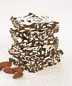 Pieces of almond chocolate, stacked