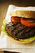 Hamburger with lettuce leaf and tomato slices