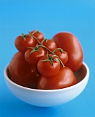 Plum and cocktail tomatoes in a bowl