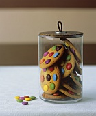 Cookies with chocolate beans in a cookie jar