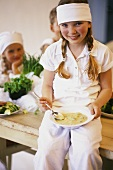 Four children cooking
