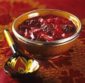 A bowl of borscht with Russian spoon