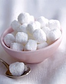 Sugar Cubes in a Bowl and on a Spoon