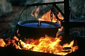 An Iron Pot Hanging over an Open Flame