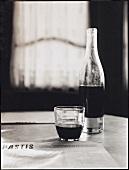 Red wine in bottle & glass on table (Pastis restaurant, USA)
