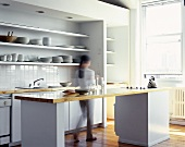 Woman walking through a modern kitchen