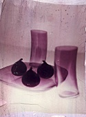 Three figs on a glass plate