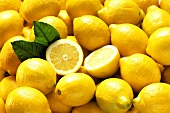 Many Whole Lemons with One Halved (Full Frame)