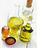 Assorted Types of Oil with a Bowl of Seeds