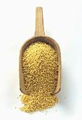 Millet in a Wooden Scoop