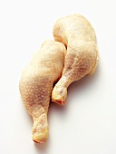 Two Uncooked Chicken Legs
