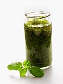 A Jar of Pesto with Basil Leaf